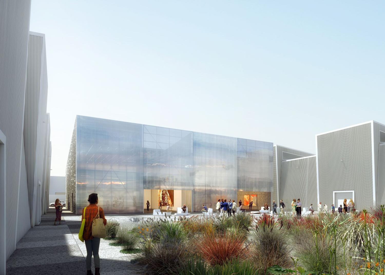Ein- und Ausblicke. Große transparente Schiebetüren vermitteln im Eingangsbereich zwischen dem Innen- und Außenraum.