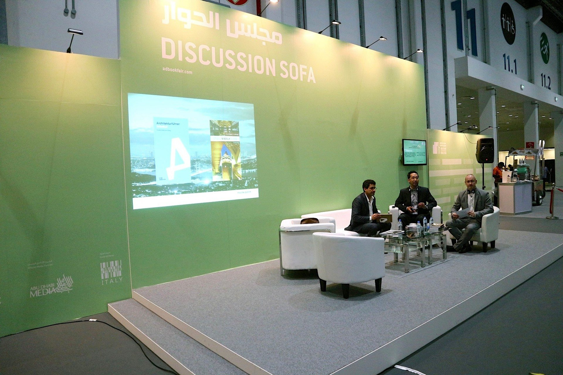 Presentation and publication.  At the Discussion Sofa of the ADIBF with host Mustafa Al-Slaiman presenting the Architectural Guide United Arab Emirates with Jan Dimog and Hendrik Bohle.