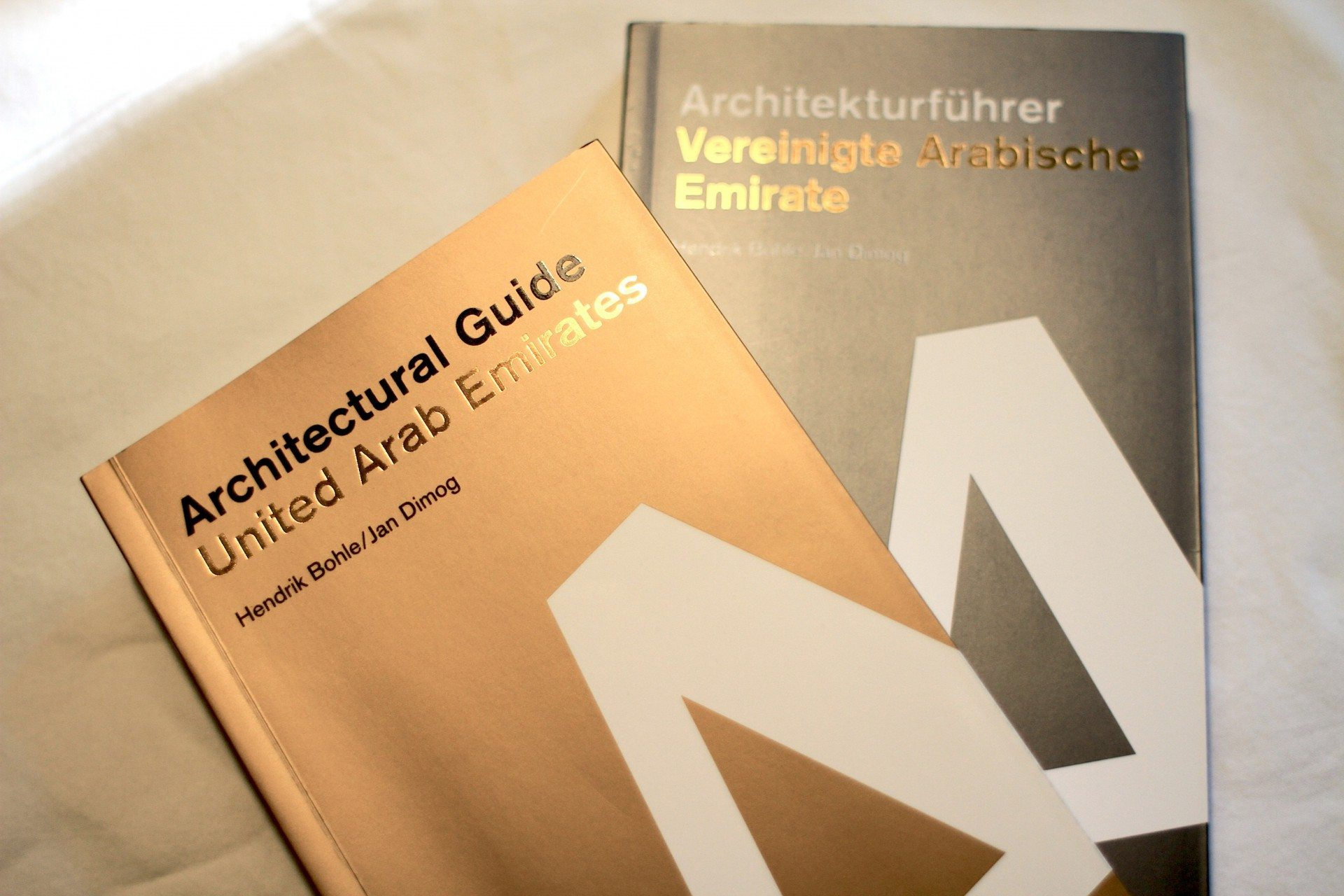 Gold and silver. Covers of the Architectural Guide United Arab Emirates by Jan Dimog and Hendrik Bohle.