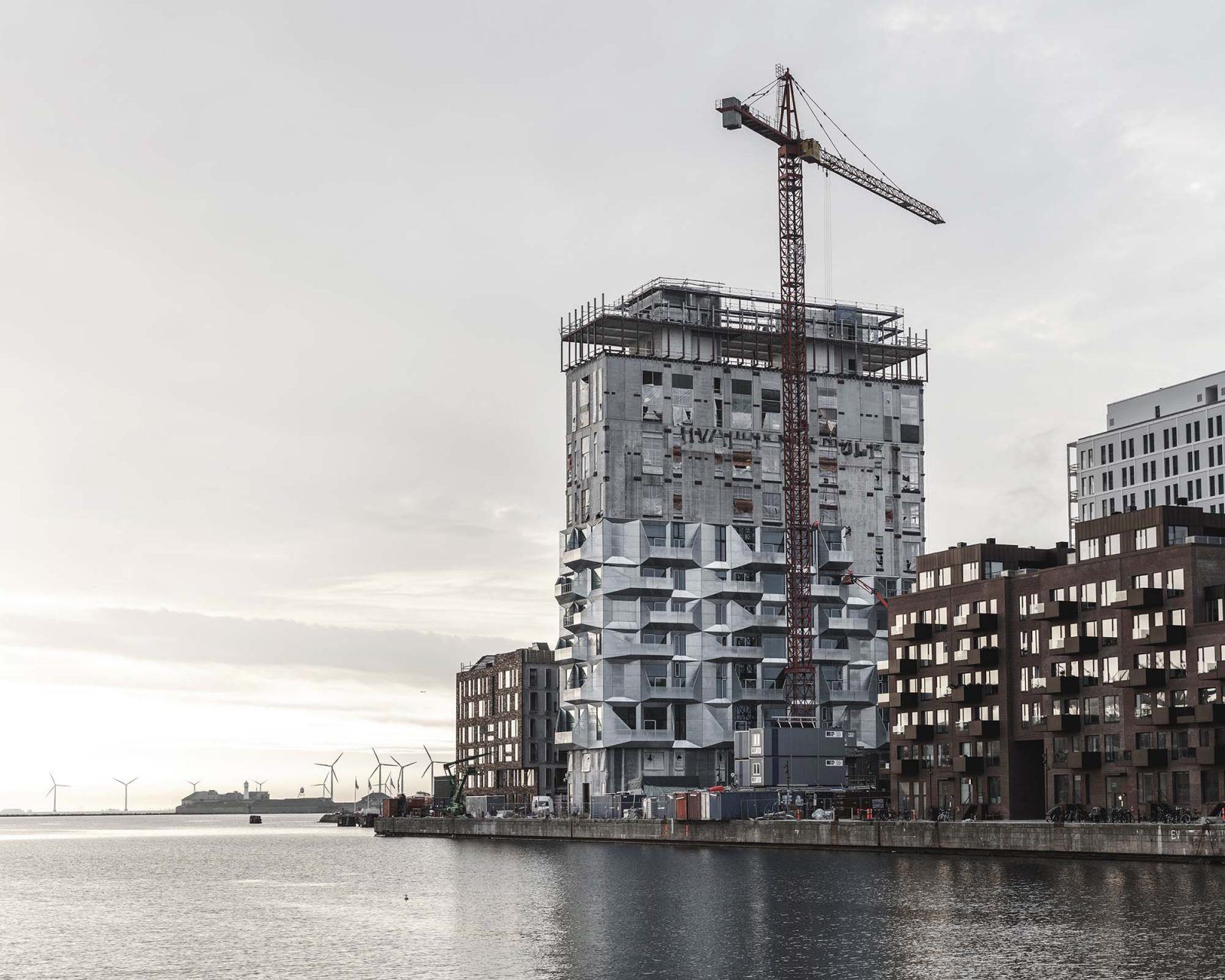 The Silo. The 62 meters and 17-storey tall transformed silo will become a natural point of orientation in Copenhagen's new neighborhood Nordhavnen. The demands for storage and handling of grain has led to magnificent spatial variation floor by floor. This will result in 40 different apartments, stacked on top of each other within the existing silo structure. In addition, public functions are located on the top and bottom floor to ensure a multi-dimensional experience for the various users of the building. The Silo will thus be inhabited, but at the same time also be a destination for all Copenhageners; a kind of urban silo.