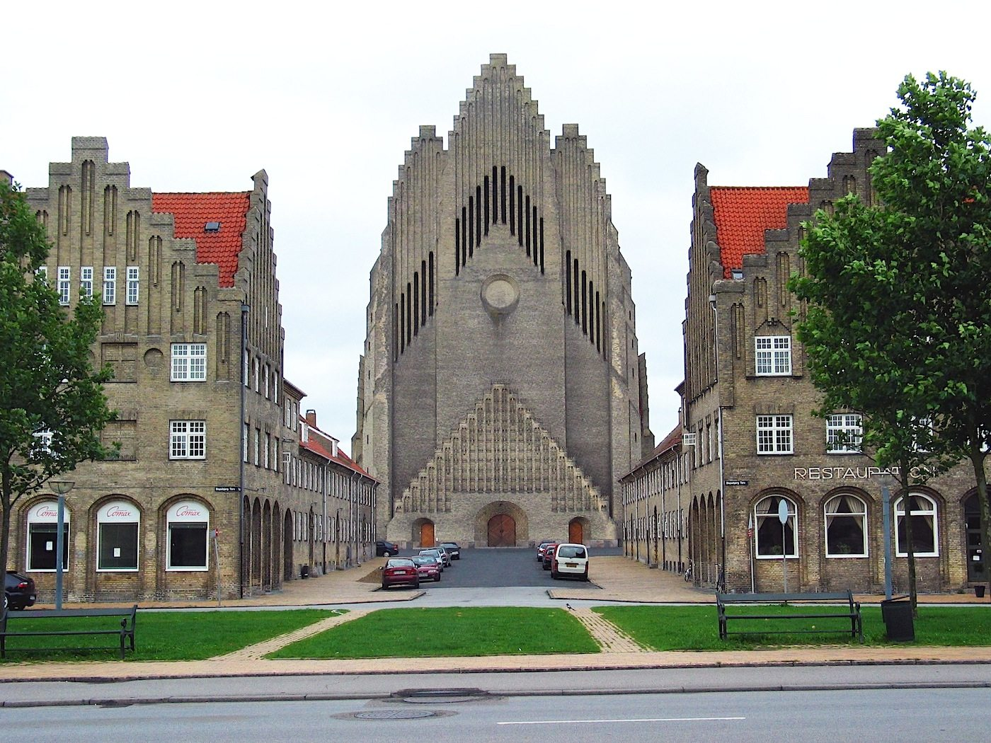 Grundtvig's Church. In Copenhagen, Denmark, seen from the west. The church was completed in 1940. Planned by Peder Vilhelm Jensen-Klint, who merged the modern geometric forms of Brick Expressionism with the classical vertical of Gothic architecture.