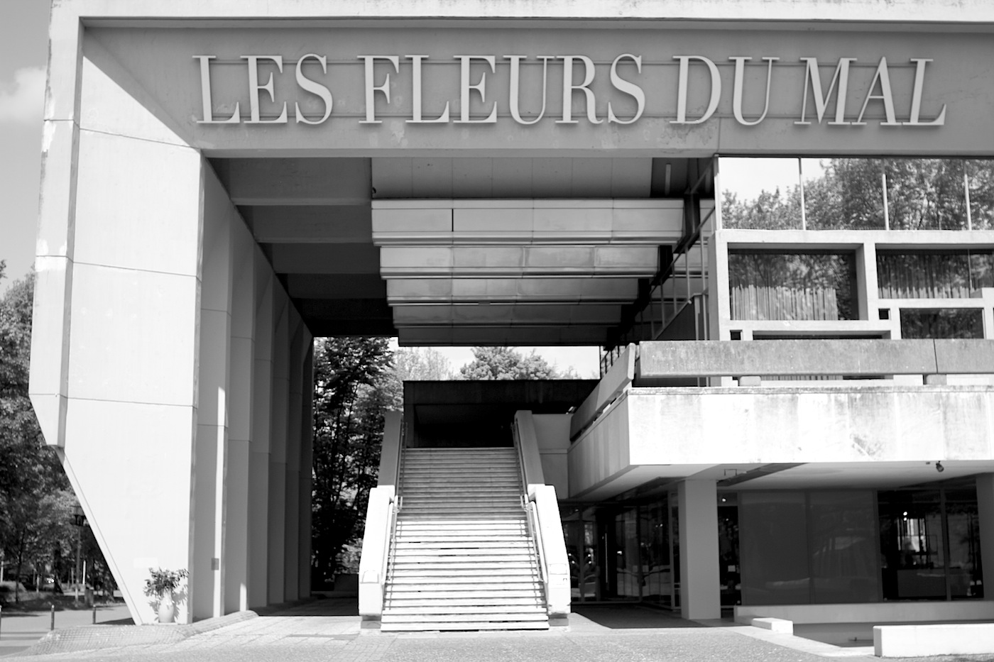 """Les Fleurs Du Mal.  """"The Flowers of Evil"""" is written on the edge of the façade of the town hall, the museum of sculptures, opened in 1982, and the free staircase to the civil registry office – an installation by the light artist, Mischa Kuball, combining the title of the poem cycle by Baudelaire with the word play Flowers for Marl."""