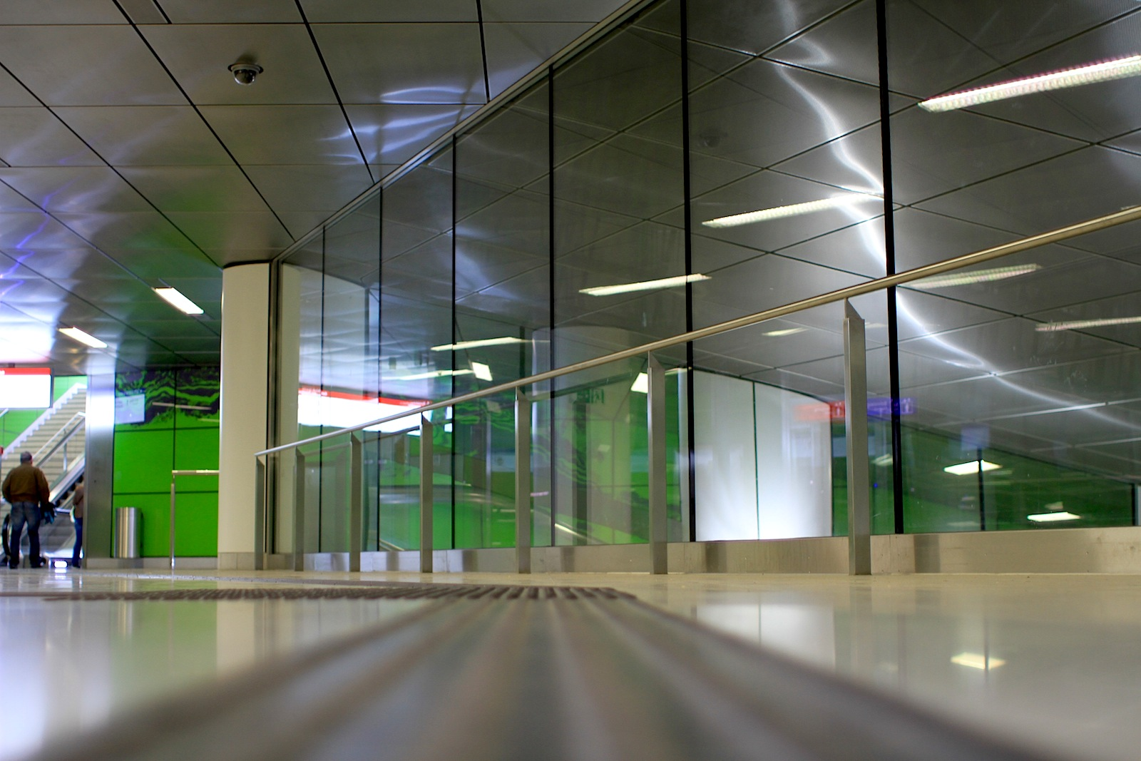 Graf-Adolf-Platz Station. Manuel Franke has used hundreds of panels of luminous green glass ...