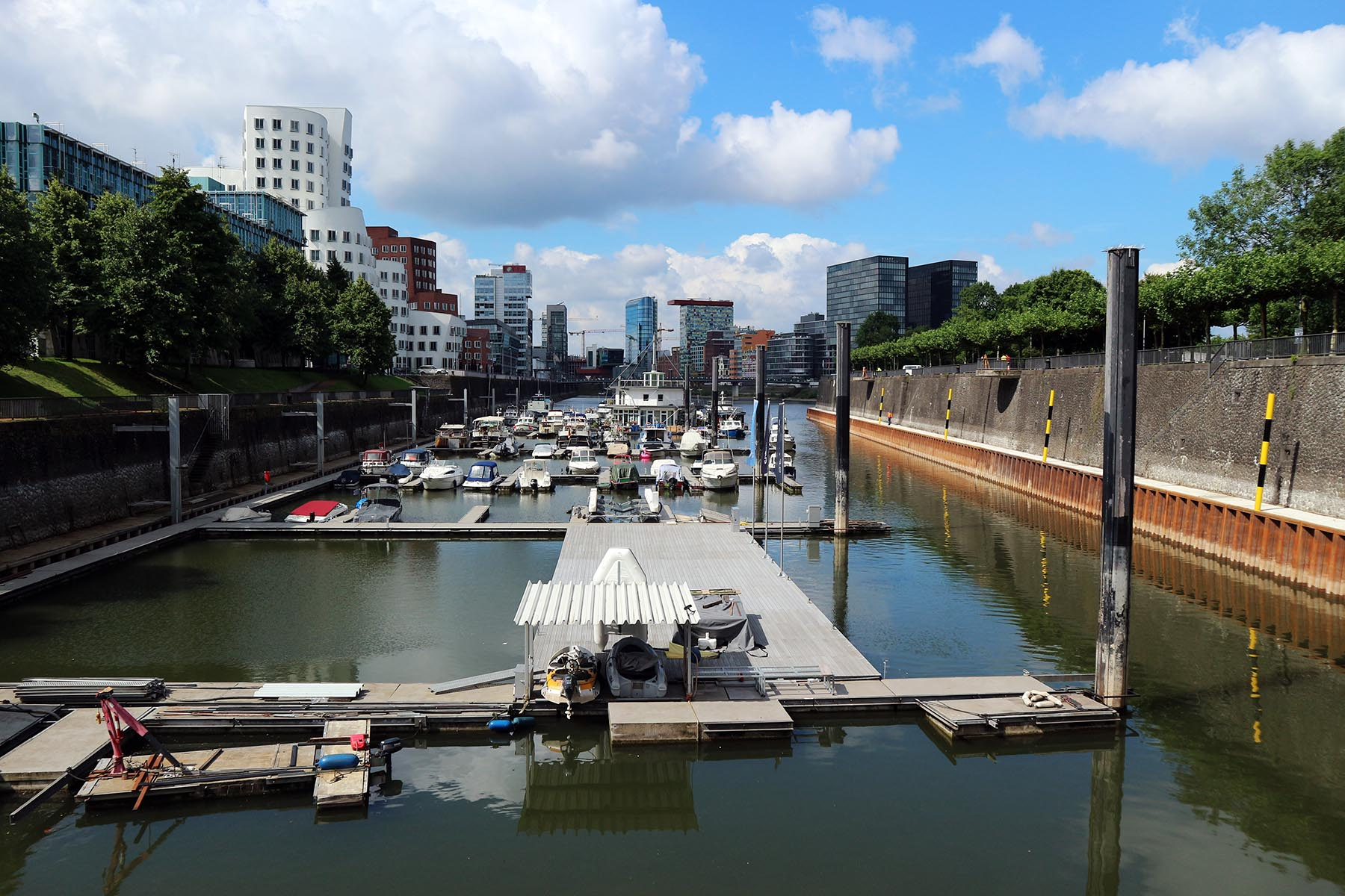 """Medienhafen Duesseldorf.  ... thus take advantage of the image of the Medienhafen, described by the architectural association of North Rhine-Westphalia as an """"Architecture Mile."""" In 1990, the city began the restructuring of the former Zollhafen (Customs Harbour)."""