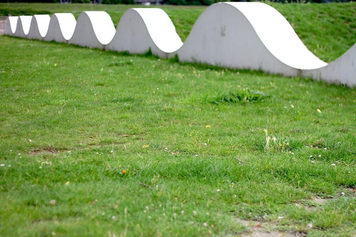 Garten der Erinnerung (memorial garden).  The lawn waves by land art artist Dani Karavan with Danielzik + Leuchter Landschaftsarchitekten bdla (planning of vegetation), Lichtwerke Int. Stefan Hofmann and Belzner Holmes Architektur Licht Bühne / Uwe Belzner.