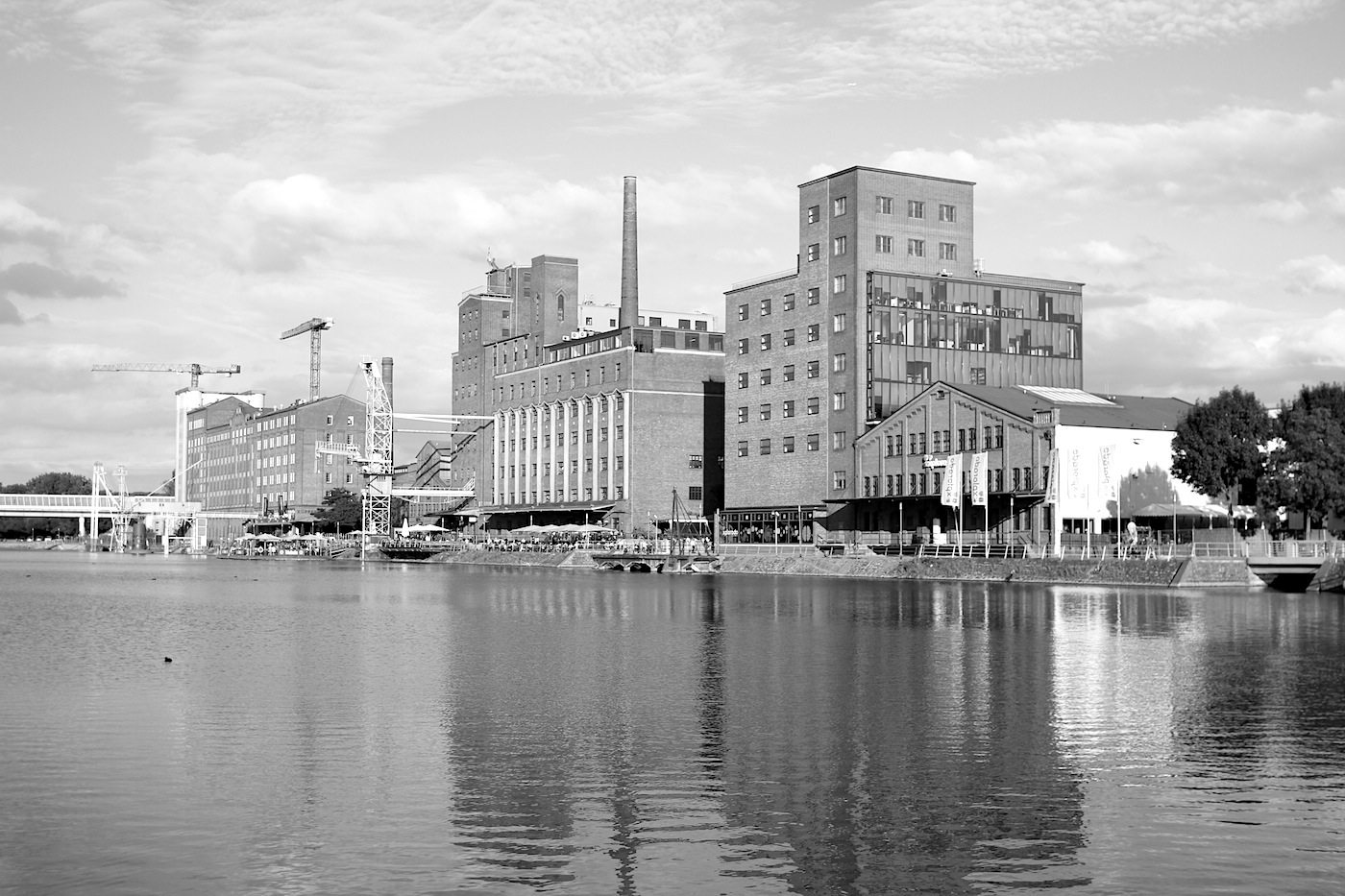 "Innenhafen Duisburg. The former centre of German grain trade, with the old mill works and the fresh, shining glass buildings, is a neo-harbour and a piece of ""anti-Duisburg."""