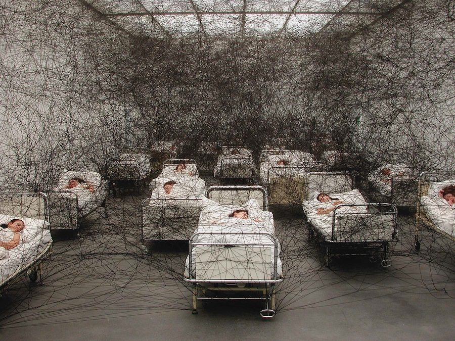 During Sleep, 2002. Kunstmuseum Luzern, Switzerland. Performance / installation. Hospital beds, bedding, black wool