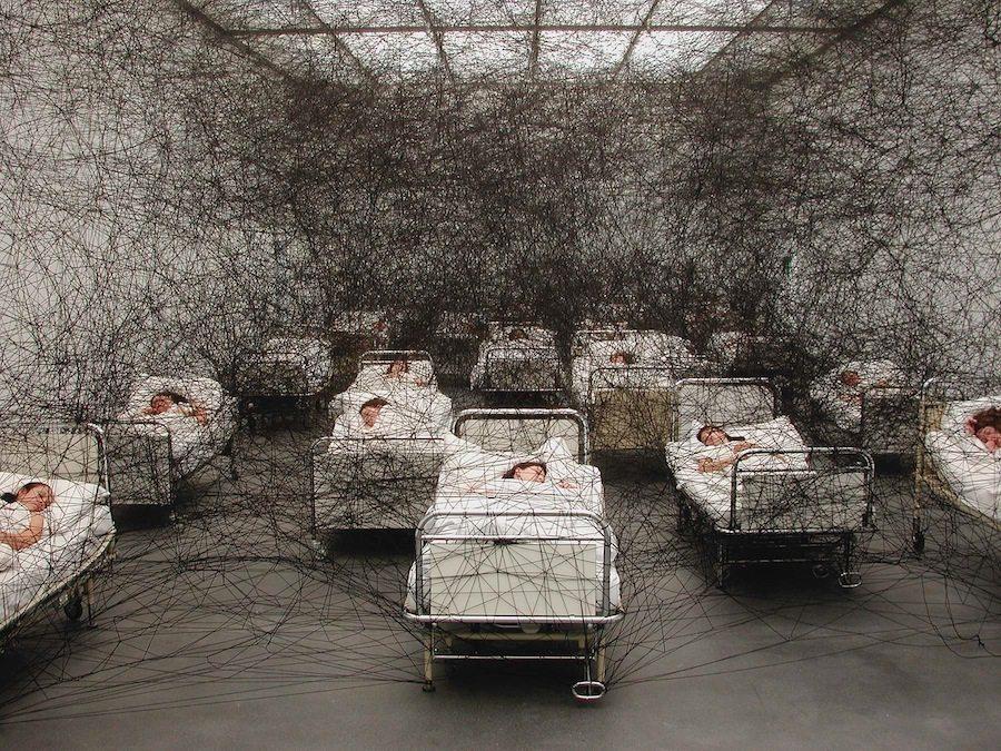 During Sleep, 2002.  Kunstmuseum Luzern, Switzerland. Performance / installation. Hospital beds, bedding, black wool