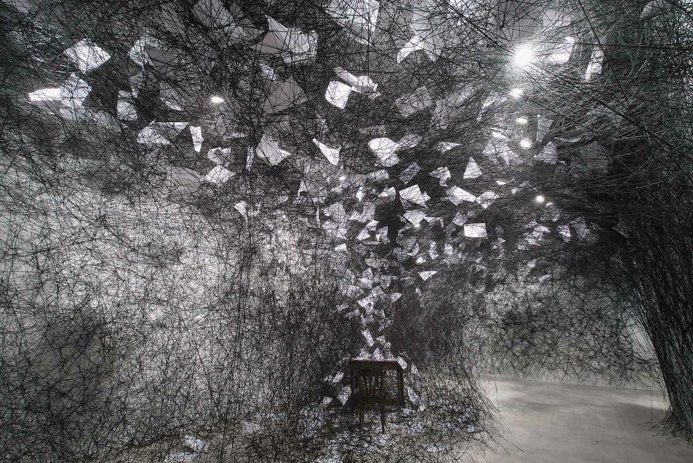 A Long Day, 2015.  K21-Kunstsammlung Nordrhein-Westfalen, Düsseldorf. Installation, papers, desk, chair, black wool