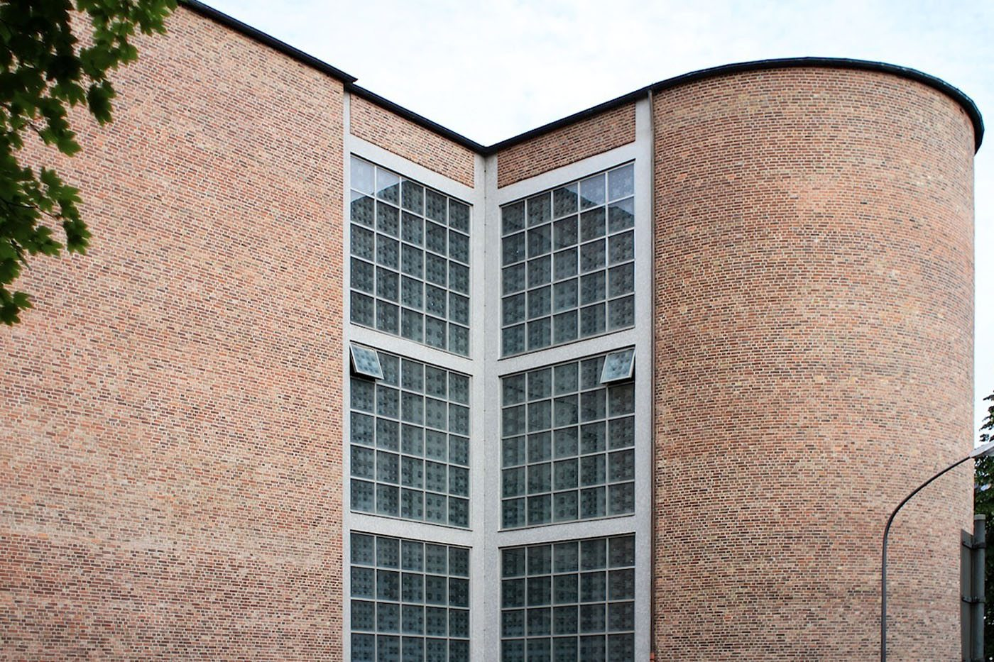 St. Andrew's Church.  The simple building with its clear, round forms, is clad with bricks.