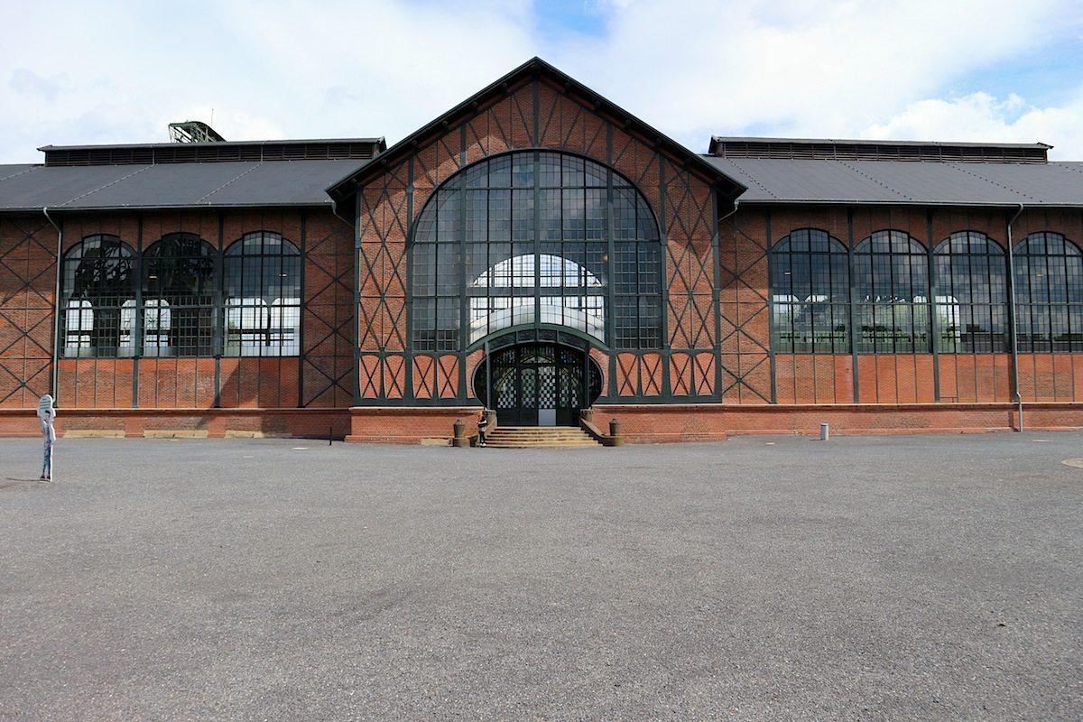 Maschinenhalle. Von Bruno Möhring als ein moderner Industriebau aus sichtbarem Stahlfachwerk mit Jugendstilelementen gestaltet. Fertigstellung: 1902.