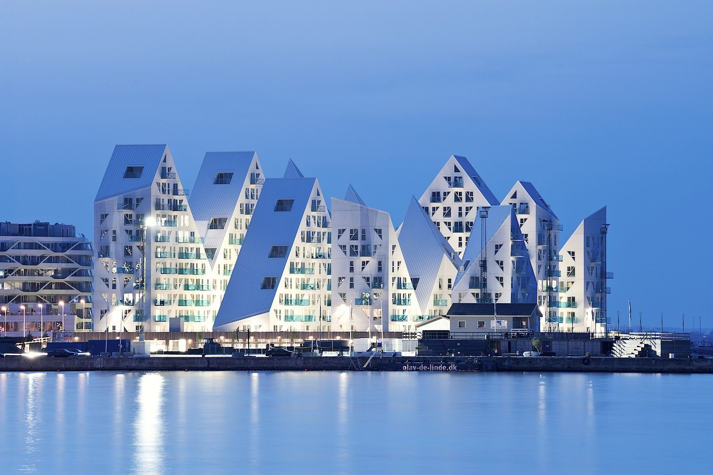 "Isbjerget, Aarhus. Completion: 2013. ""The Iceberg"" has 208 apartments with roofs, that rise and fall into peaks and valleys."