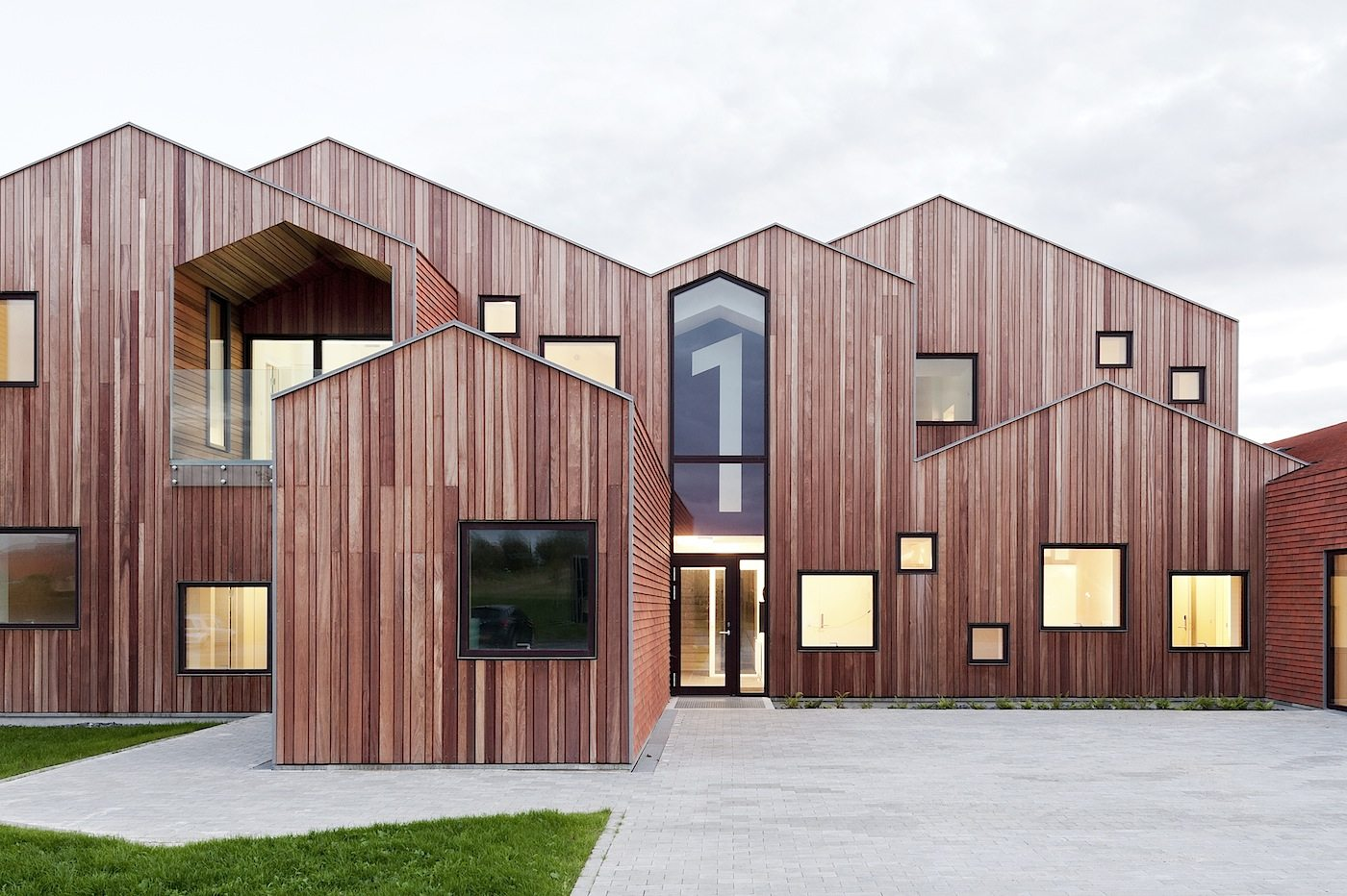 "Children's home of the future, Kerteminde.  ""Our House"" is basically organized as four interconnected houses in order to reduce the building's scale and to create self-contained, varied units for the different groups of residents."