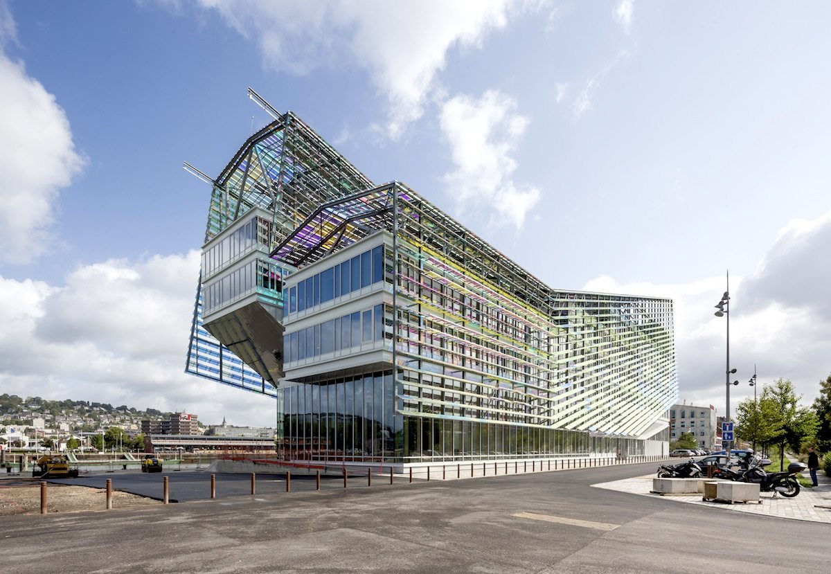 Headquarters of Métropole Rouen Normandie.  The building is covered with fish-like 'scales' made of subtly coloured glass.