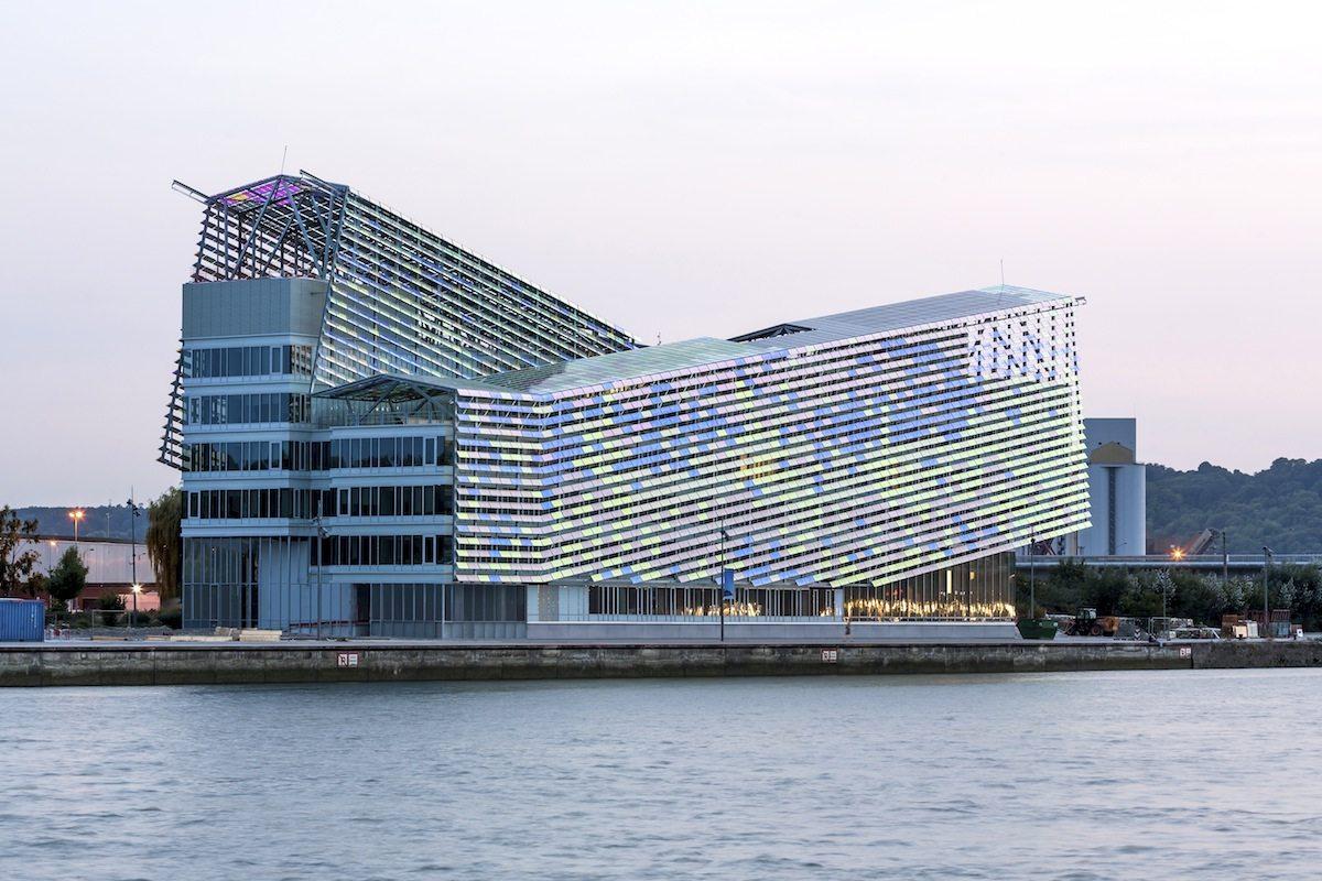 Headquarters of Métropole Rouen Normandie.  The building's dynamic profile contrasts with ...